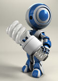 Blue robot holding compact light bulb Stock Photo