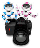 Blue robot and pink robot Big Camera the photographing. Create 3 Royalty Free Stock Image