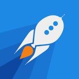 Blue Rocket Flying. White Rocket on Blue Background Stock Images