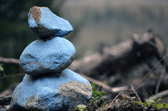 Blue Rocks. A stack of three painted blue rocks Royalty Free Stock Image