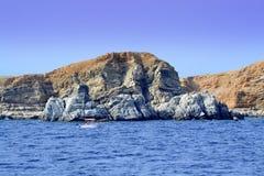 Rocky island summer holiday getaway. Chalkidiki uninhabited rocky island blue sea water,sailing motorboat,September 2014,Aegean sea Greece Stock Photos