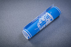 Blue rolled blueprint on grey background construction concept Royalty Free Stock Image