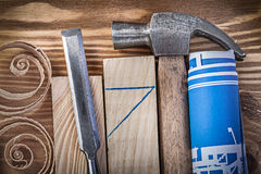 Blue rolled construction drawing claw hammer firmer chisel woode Royalty Free Stock Image