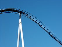 Blue Roller Coaster. Blue twisted roller coaster track with beam support Royalty Free Stock Photography