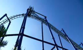 View from bottom of roller coaster rail and blue sky royalty free stock photography