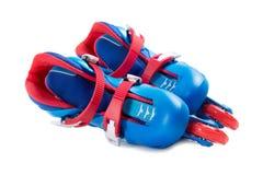 Blue roller skates isolated on white Stock Photo