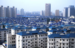 Blue roof blocks. The roof of the building and distant blue high-rise building Royalty Free Stock Photos