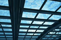 Blue roof. And dappled cloudy blue sky Royalty Free Stock Photography