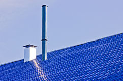 Blue roof with pipes Stock Image