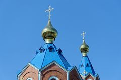 Blue roofs of russian orthodox church against clear blue sky. Cathedral of Our Lady of Kazan. In Komsomolsk-on-Amur in Russia stock images