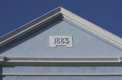 Blue rooftop against blue sky. House built in 1883, London, Europe Royalty Free Stock Image