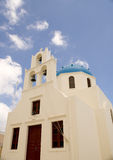 Blue roofWhite bell. Bells  in the Oia city on the Santorini Island Stock Image