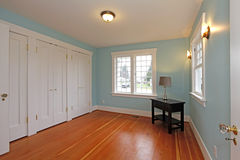 BLue room with cherry floor and white closet doors Stock Photography