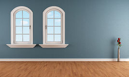 Blue room with two arched windows Royalty Free Stock Photos