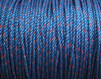 Blue rope. Strong coiled rope in blue and red Stock Images