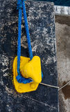Blue Rope Around Yellow Cleat Royalty Free Stock Images
