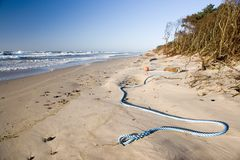Blue rope on beach royalty free stock image