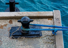 Blue Rope on Black Iron Cleat Royalty Free Stock Photos
