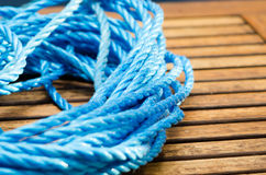 Blue rope on boat deck Royalty Free Stock Images