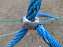 blue rope cables fastened together with a metal fastener