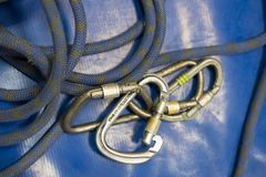 Blue rope for climbing in a gym lying on a soft Mat royalty free stock images