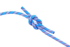 Blue rope knot. Isolated on white background Royalty Free Stock Images