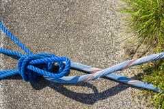 Blue Rope And Knot On asphalt Royalty Free Stock Photography