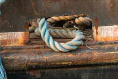 Blue rope left laying on the deck of a deep sea fishing and oyst. Er trawler Stock Photo