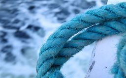 Blue rope on a ship. A closeup of a thick rope on a ship Stock Image
