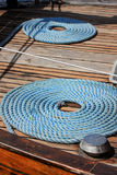 Blue ropes. Rolled in order on the boat deck Royalty Free Stock Image