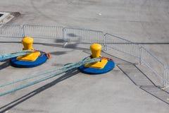 Blue Ropes on Yellow Bollards Royalty Free Stock Image