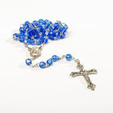 Blue rosary isolated on the white background Royalty Free Stock Photos