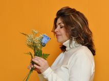Mother recieves a blue rose as a present for her b Royalty Free Stock Image