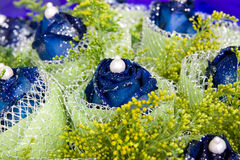 Blue rose. In gift flowers  with some small shinning white things Stock Images