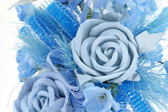 Blue Rose. Decorated with another blue flowers Stock Photography