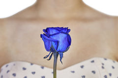 Blue rose and decollete woman Stock Images