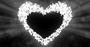 Blue Rose Flower Petals In love Heart Shape Background Placeholder Loop 4k. Flying blue rose flower petals love heart placeholder valentine wedding background stock footage