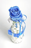Blue rose in the glass bottle with pearls Royalty Free Stock Photo