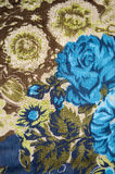 Blue rose and green floral fabric. Blue rose and green floral textile on fabric Stock Photos