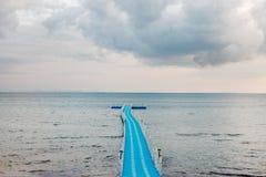 Blue rotomolding or plastic jetty in rainy season. Blue rotomolding or plastic jetty under big cloudy sky in rainy season , ko Samui , Thailand Royalty Free Stock Photography
