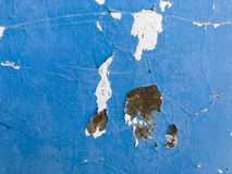 Blue rough surface with cracked paint stains. Texture royalty free stock image