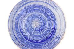 Blue round ceramic plate with spiral pattern, isolated on white. Blue round ceramic plate with spiral pattern, isolated on the white Royalty Free Stock Photography
