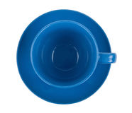 Blue round empty tea cup on a saucer Royalty Free Stock Images