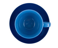 Blue round empty tea cup on a saucer Royalty Free Stock Photos