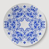 Blue round floral ornament.  Pattern applied to the ceramic plate. Vector illustration Stock Images