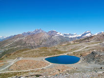 Blue round lake in mountains Royalty Free Stock Photography