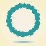 Blue round made of ink splashes with drop shadow. Royalty Free Stock Image