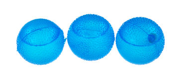 Blue round plastic ice cubes. Three blue filled plastic ice cubes on a white background Stock Photo