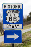 Blue Route 66 Historic Byway Sign. Blue and silver Route 66 sign designating the road a historic byway.  Blue and silver arrow sign to mark the direction of the Royalty Free Stock Image