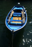 Blue row boat Stock Images